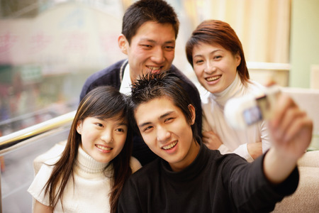 adults: Young adults posing for photograph LANG_EVOIMAGES