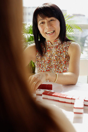 Woman playing mahjong, portrait