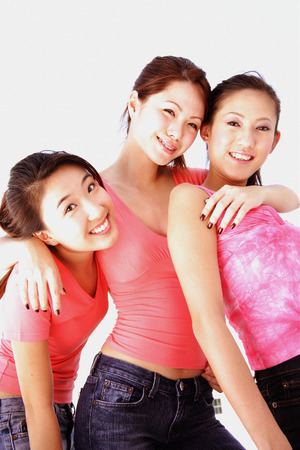 southeast asian ethnicity: Young women posing for camera LANG_EVOIMAGES