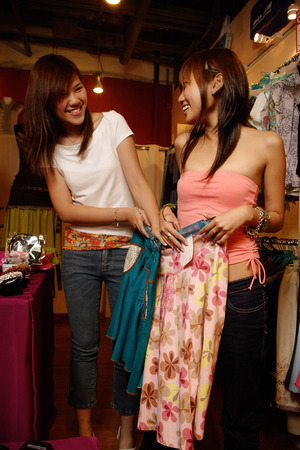 tube top: Two women at shop, looking at clothes