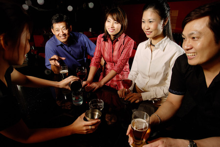 cocktail mixer: Couples drinking at bar, bartender serving them