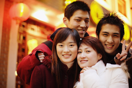 Young adults looking at camera, smiling
