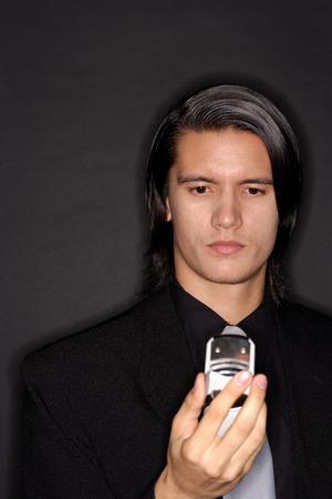 southeast asian ethnicity: Executive holding mobile phone, portrait