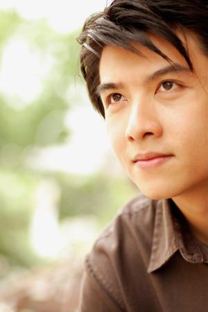 southeast asian ethnicity: Young man, head shot, looking away