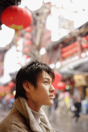 Young man looking away, profile 写真素材