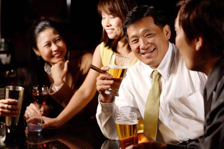 cocktail mixer: Couples at bar, drinking