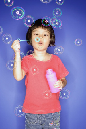 3 4 years: Young girl blowing bubbles from bubble wand LANG_EVOIMAGES