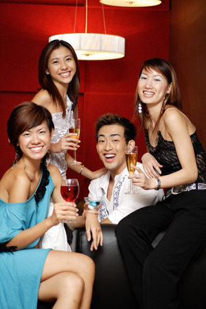 southeast asian ethnicity: Young adults, holding drinks and smiling at camera