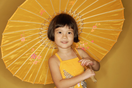 3 4 years: Young girl carrying umbrella, smiling