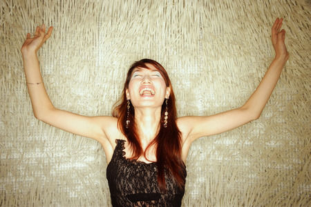 anguished: Young woman, arms outstretched, shouting