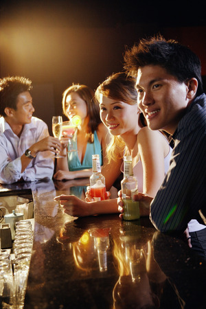 adults: Young adults sitting at bar