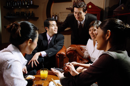 Executives sitting together having drinks Stock Photo - 67726545