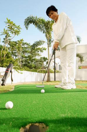 woman golf: Senior woman playing golf