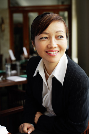 Businesswoman looking away, smiling