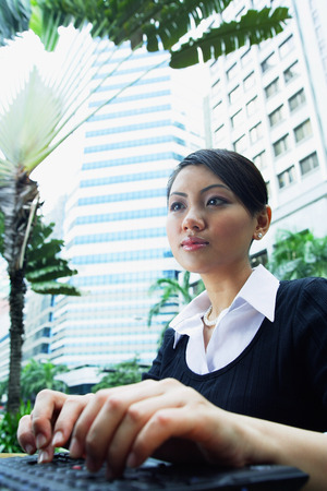 angle view: Business woman using laptop, low angle view LANG_EVOIMAGES