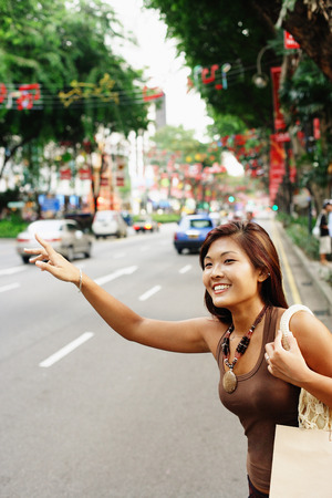Young woman, flagging a cab