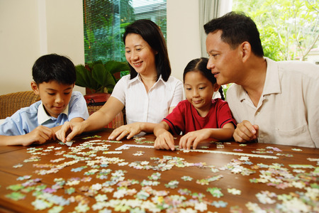 family  room: Family playing jigsaw puzzle in living room