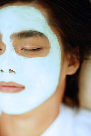 metrosexual: Young man with facial mask, eyes closed