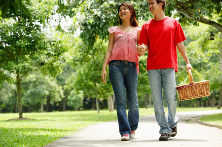 Couple walking in park, holding hands
