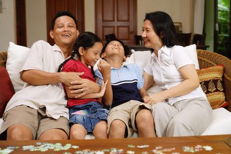 family  room: Family in living room, bonding, portrait