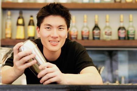 cocktail mixer: Man holding cocktail mixer