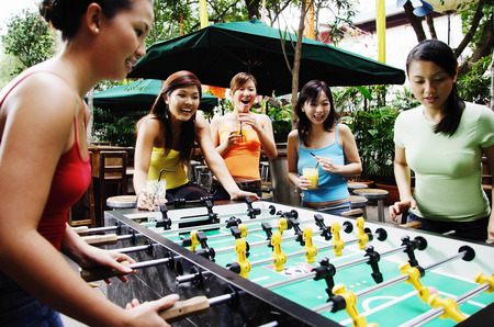 foosball: Young women playing foosball