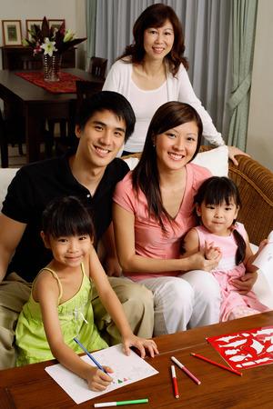 Three generation family looking at camera, portrait