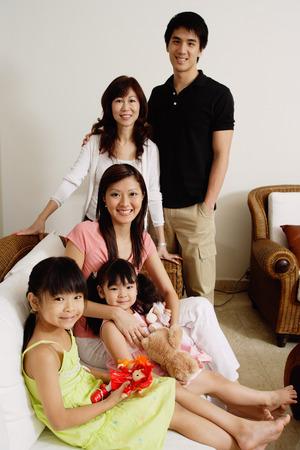 three generation: Three generation family looking at camera