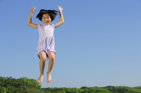 mid air: Girl jumping in mid air, smiling