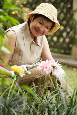 only 1 person: Woman doing gardening