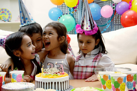 Children at a birthday party having a good time Stock Photo