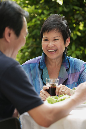 Mature couple dining at the restaurant