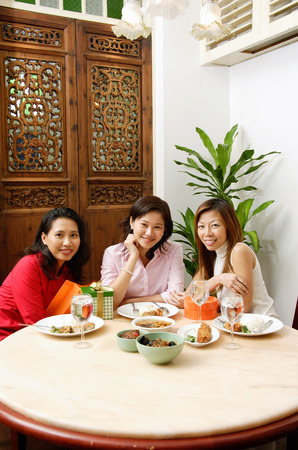 Three women looking at camera, smiling
