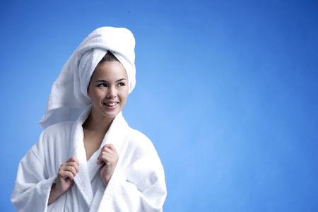 woman bathrobe: Young woman wearing white bathrobe and towel turban LANG_EVOIMAGES