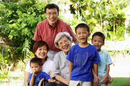 three generation: Three generation family, smiling at camera