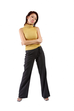 Young woman standing, arms crossed Banco de Imagens