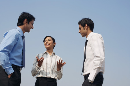 conversing: three business colleagues, conversing