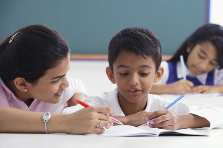 librarians: teacher helps student with schoolwork LANG_EVOIMAGES