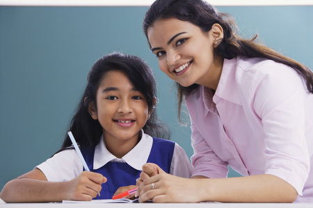 librarians: teacher and student smile at camera (horizontal)