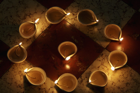 Lit clay oil lamps in a circle