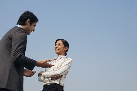 and the horizontal man: woman and man discussing business (horizontal)