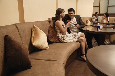 evening wear: two couples in restaurant LANG_EVOIMAGES