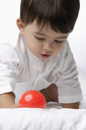 baby boy with red ball Stock Photo