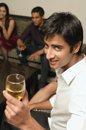 man facing camera with glass of wine