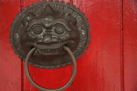 Decorative chinese door knocker Фото со стока