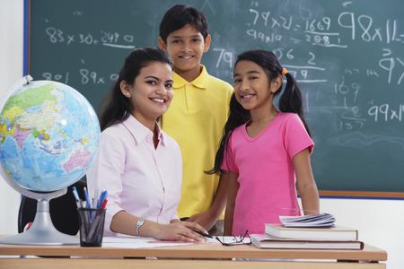 librarians: teacher with two students, all smiling at camera