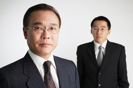 mature business man: Two Businessmen looking at camera LANG_EVOIMAGES