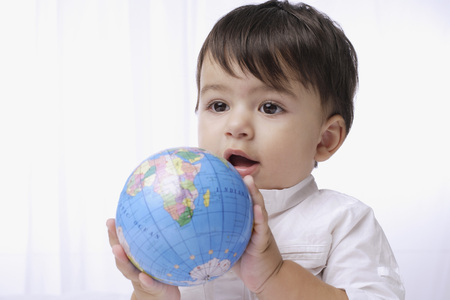 european ethnicity: baby boy holding globe LANG_EVOIMAGES