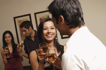 woman smiling in conversation with guy at party (horizontal)