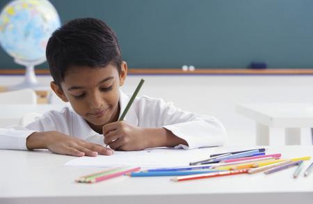 boy concentrates on schoolwork